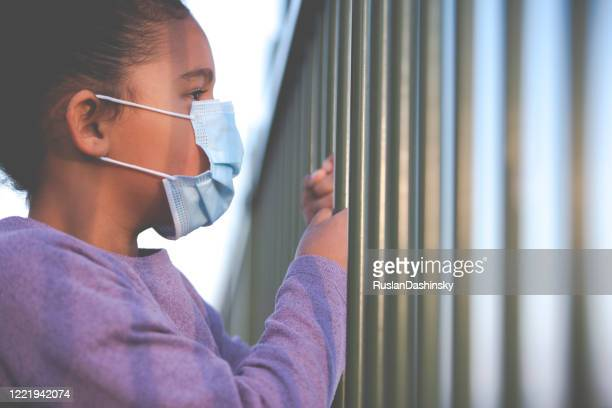 social distancing comes with the child's psychological fallout. - child behind bars stock pictures, royalty-free photos & images