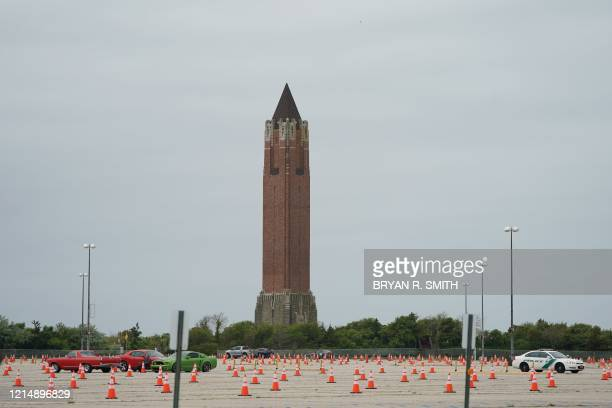 Social distancing cones are placed in alternating parking spaces at Jones Beach on May 24 2020 on Long Island New York Parts of the state that saw...