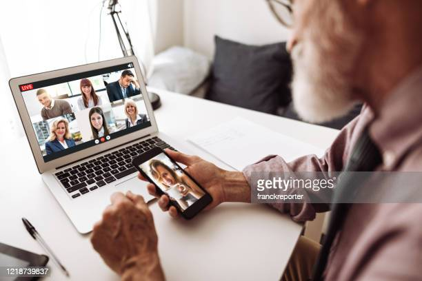 social distancing family doing a voice ip phone call - family politics stock pictures, royalty-free photos & images