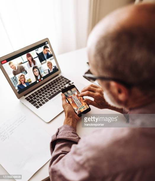 social distancing family doing a voice ip phone call - video still stock pictures, royalty-free photos & images