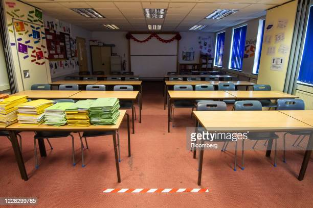 Social distancing floor marker sits in a classroom at All Saints Catholic College ahead of reopening for students in Manchester, U.K., on Tuesday,...