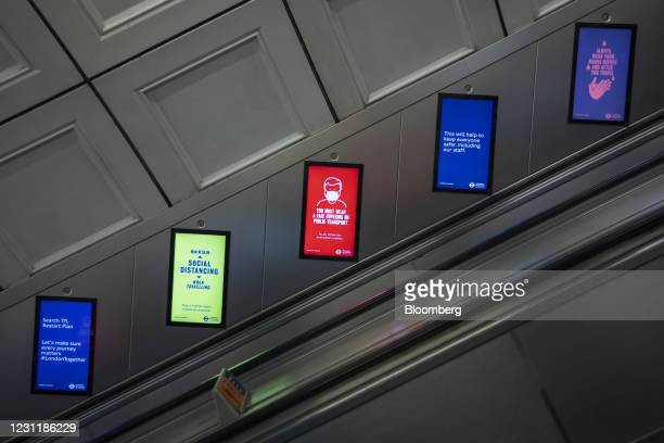 Social distancing guidelines on electronic signs on the London Underground in the City of London, U.K., on Monday, Feb. 15, 2021. The U.K. Recorded...