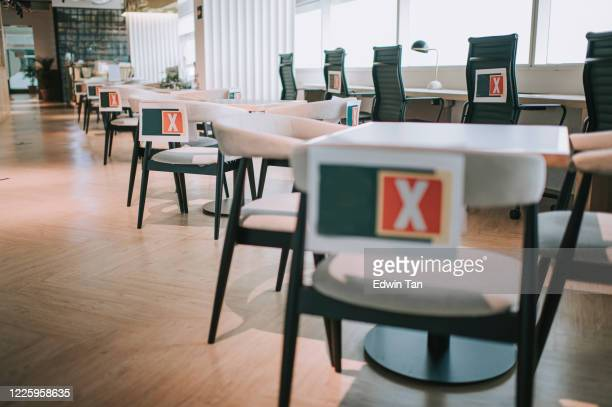 social distancing in co sharing office with sign for safety distance - instructions stock pictures, royalty-free photos & images