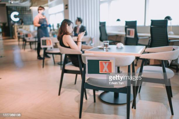 social distancing in co sharing office with sign for safety distance - distant stock pictures, royalty-free photos & images