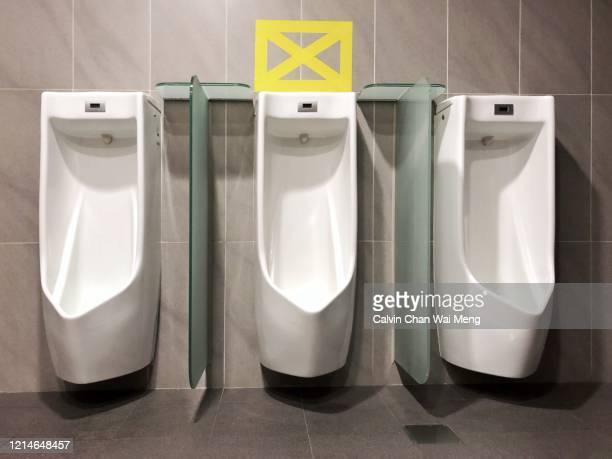 social distancing in men toilet - information sign stock pictures, royalty-free photos & images