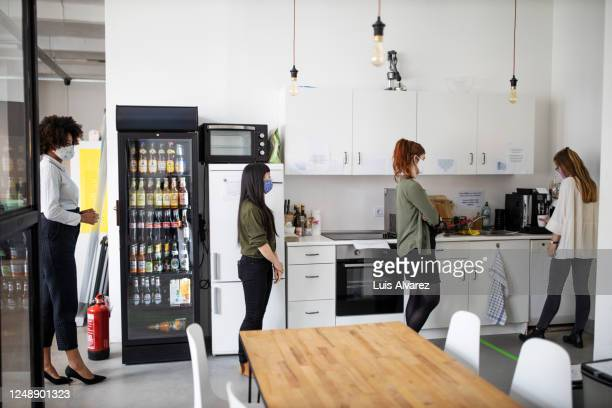 social distancing in office cafeteria - canteen stock pictures, royalty-free photos & images