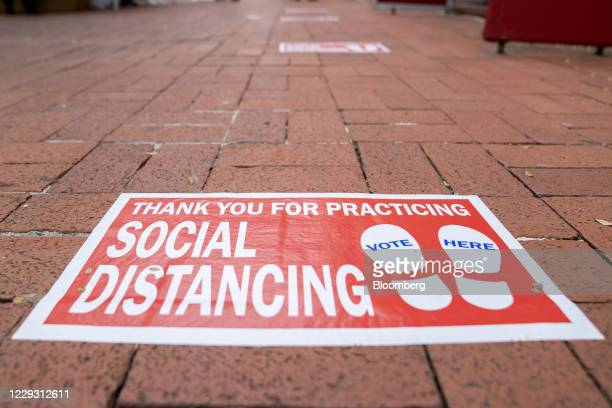 Social distancing marker outside an early voting polling location for the 2020 Presidential election at Capital One Arena in Washington, D.C., U.S.,...