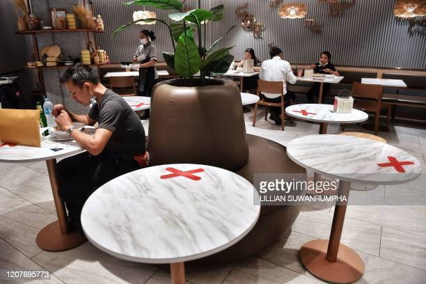 TOPSHOT Social distancing markers are pictured on food court tables in a shopping mall amid concerns over the spread of the COVID19 coronavirus in...