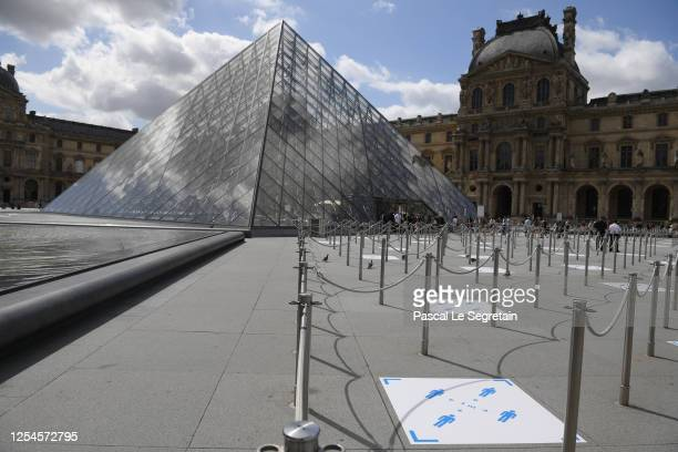 Social distancing marks are seen on the floor outside the Louvre museum as it reopens its doors following its 16 week closure due to lockdown...