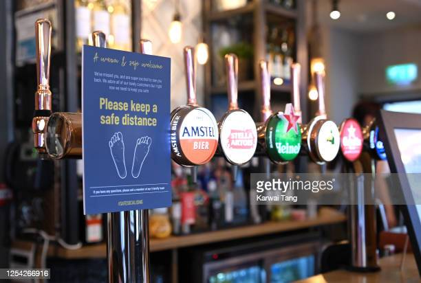 Social distancing measures in place before customers return to the Wellington Pub on July 04, 2020 in Borehamwood, England. The UK Government...
