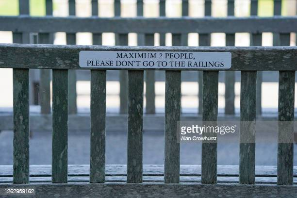 Social distancing notice on a bench at Goodwood Racecourse on July 31 2020 in Chichester England Owners are allowed to attend if they have a runner...