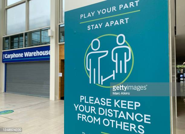 Social distancing notices are seen inside the Centre MK shopping centre on June 09, 2020 in Milton Keynes, England. As the British government further...