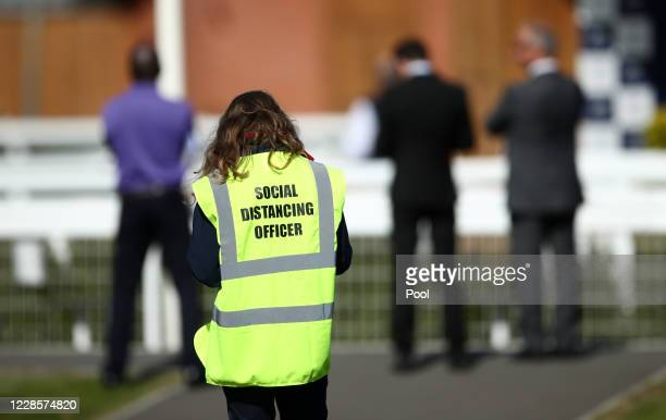 A social distancing officer at Newbury Racecourse on September 18 2020 in Newbury England