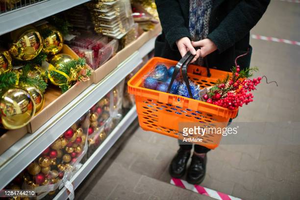 social distancing on christmas shopping during covid-19 - lining up stock pictures, royalty-free photos & images