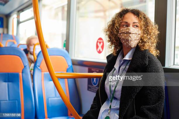 social distancing on the bus - public transport stock pictures, royalty-free photos & images