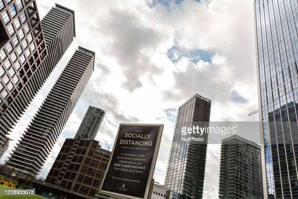 Social distancing poster is seen at Canary Wharf financial skyscrapershub as the secondwave of Coronavirus hits London, England on October 6, 2020.