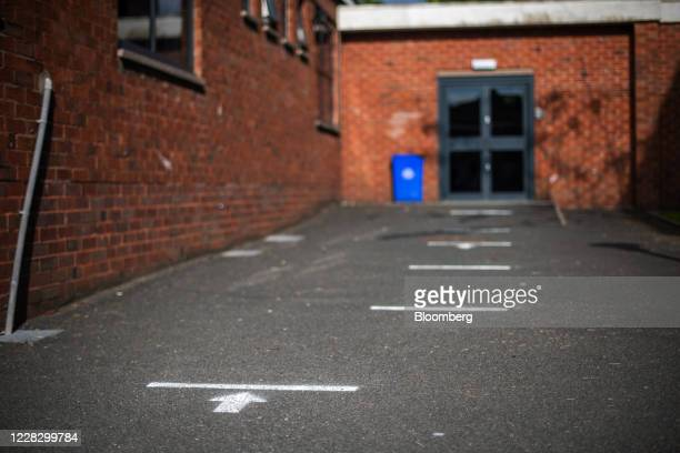 Social distancing queue markers sit on the playground floor at All Saints Catholic College ahead of reopening for students in Manchester UK on...