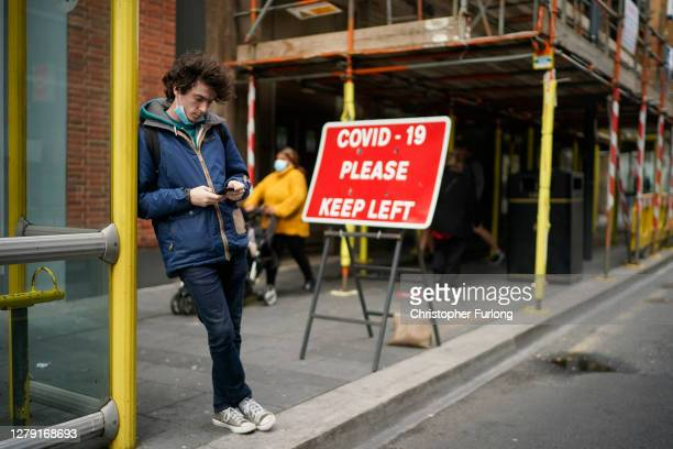 Social distancing sign advises pedestrians on October 08, 2020 in Liverpool, England. It has been reported that a three-tier lockdown system, similar...