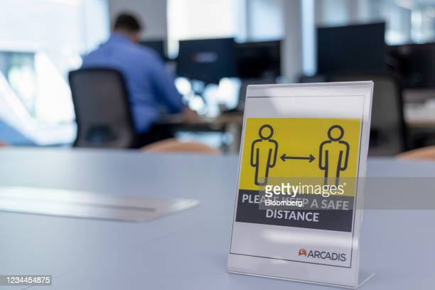 Social distancing sign at the offices of Arcadis NV, after increasing their workplace capacity on July 19, in London, U.K. On Monday, Aug. 2, 2021. A...