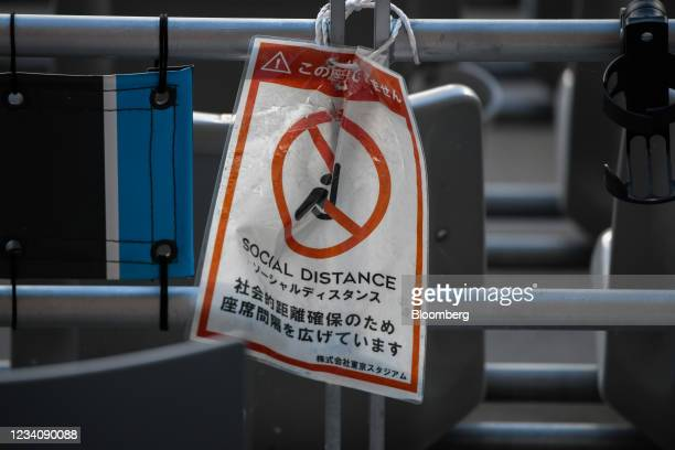 Social distancing sign hangs in the seating area during an opening round women's football match between the U.S. And Sweden at the Tokyo 2020 Olympic...