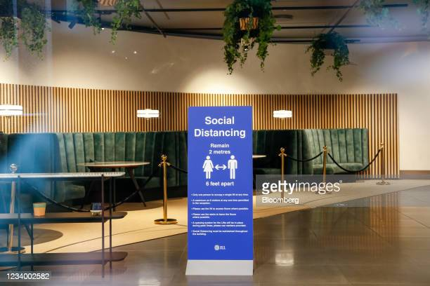 Social distancing sign in the foyer of an office building in the City of London, U.K., on Thursday, July 15, 2021. On Monday, Englands white-collar...