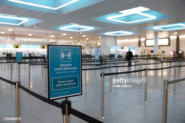 Social distancing sign inside the North Terminal at Gatwick Airport on February 6, 2021 in London, England. The UK Government has confirmed that...
