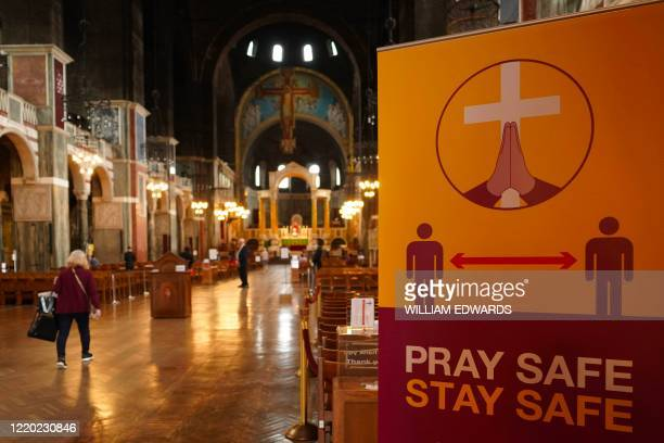 A social distancing sign is seen as worshipers visit Westminster Cathedral in London on June 15 2020 after the church reopened for private prayer...