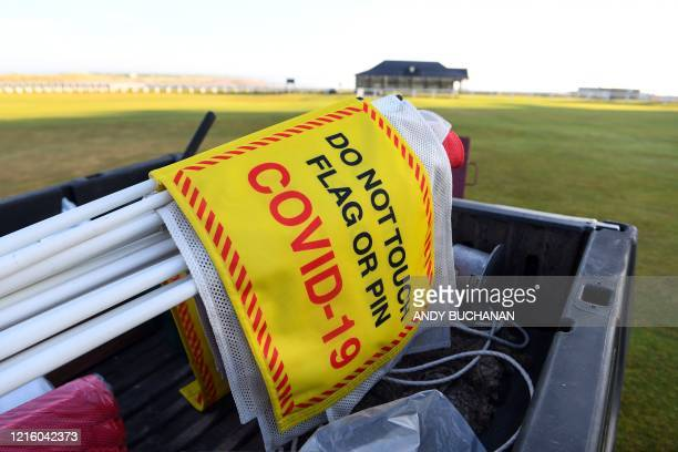 Social distancing sign is transported across the green at The Old Course in St Andrews, Scotland on May 29 as the Scottish Government eases lockdown...