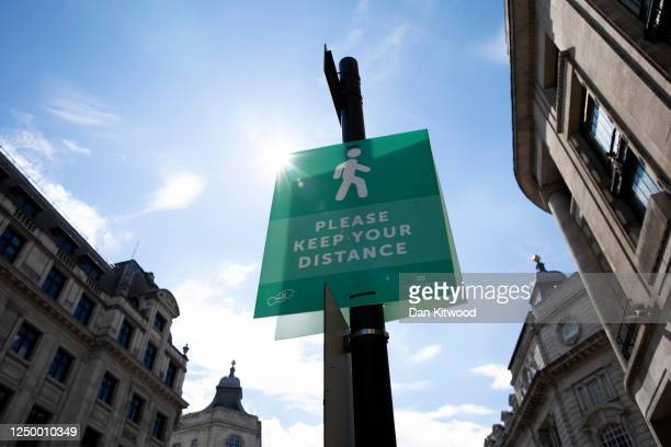 Social distancing sign on Regent Street as non-essential stores re-open for the first time since the nationwide lockdown came into force, on June 16,...