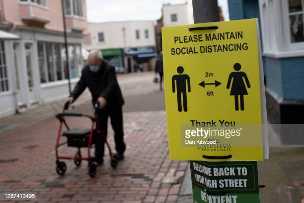 Social distancing sign on the high street on November 24, 2020 in Faversham, Kent. The Swale Valley borough in Kent currently has the highest rate of...