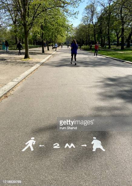 social distancing signage as victoria park reopens - ビクトリア公園 ストックフォトと画像