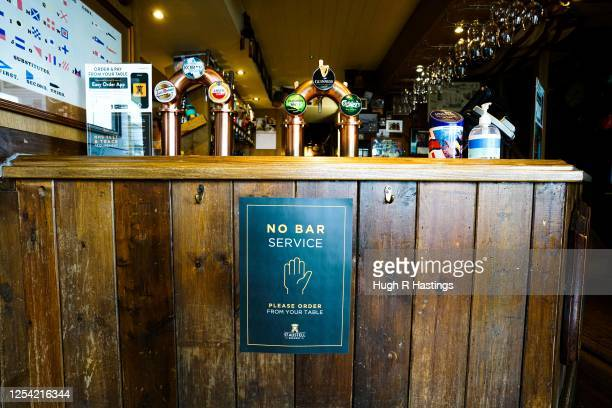 Social distancing signage at The Chain Locker pub as it reopens for business on July 4 2020 in Falmouth Cornwall United Kingdom The UK Government...