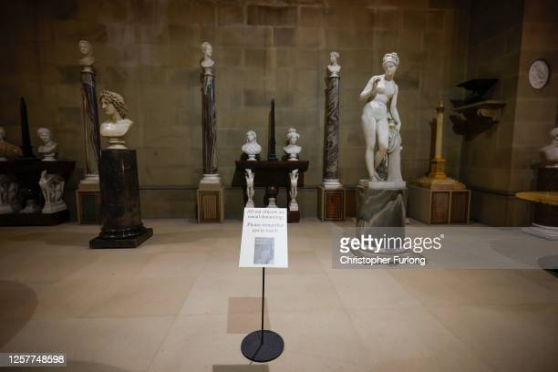 Social distancing signage is seen in the sculpture gallery of Chatsworth House as the Derbyshire stately home prepares to reopen to the public after...