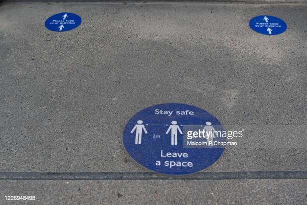 social distancing signage used during covid 19 - social distancing stock pictures, royalty-free photos & images