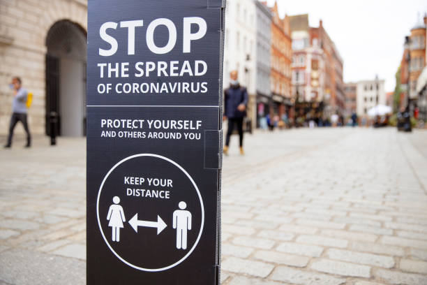 social distancing signs and notices in urban streets - covid sign london stock pictures, royalty-free photos & images