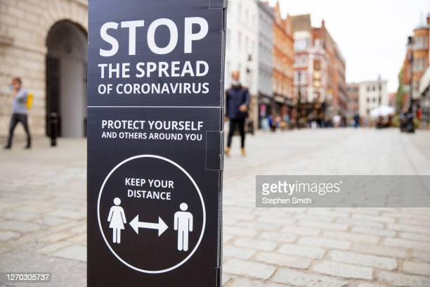social distancing signs and notices in urban streets - central london stock pictures, royalty-free photos & images