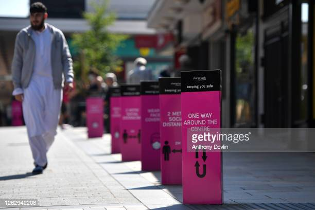 Social distancing signs are displayed in Burnley town centre on July 31, 2020 in Burnley, England. Lockdown has been heightened in parts of England...