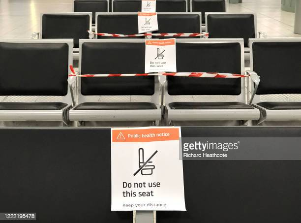 Social distancing signs are seen around London Luton Airport as WizzAir resumes passenger flights on May 01, 2020 in Luton, United Kingdom. British...