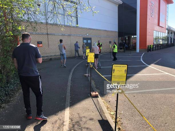 Social distancing signs are seen at BQ DIY store as it reopens its doors to the public on April 21 2020 in Cardiff Wales The British government has...
