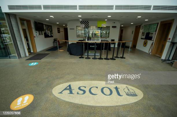 Social distancing signs are seen inside the Weighing-Room at Ascot Racecourse on June 14, 2020 in Ascot, England. As a result of the Coronavirus...