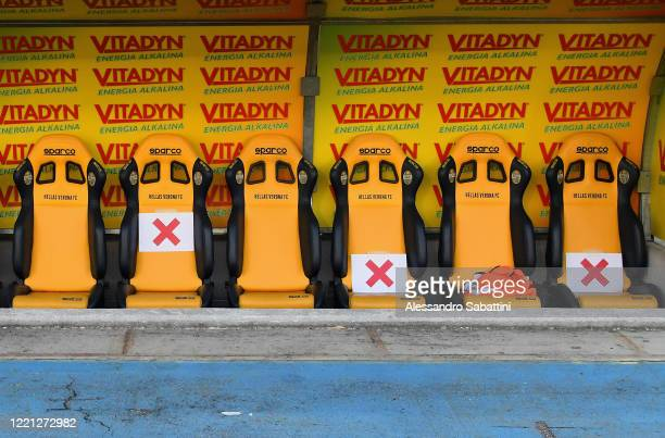 Social distancing signs on the substitutes' bench ahead of during the Serie A match between Hellas Verona and Cagliari Calcio at Stadio Marcantonio...