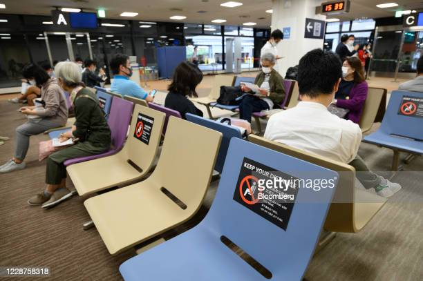 Social distancing signs sit on a bench at Narita Airport in Narita, Japan, on Saturday, Sept. 26, 2020. Japan Airlines Co. Operated a 3.5-hour...