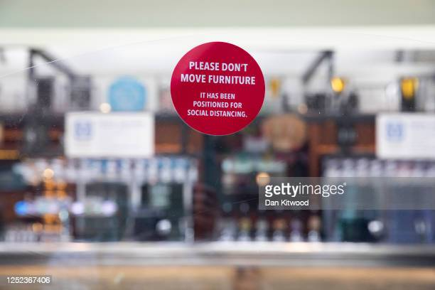 Social distancing stickers at a branch of Weatherspoons in Muswell Hill as it prepares for reopening on June 25 2020 in London United Kingdom...