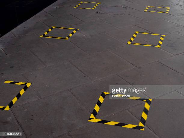 "Social distancing tape on the floor at Finsbury Park station ticket office on April 22, 2020 in London, England. Taped-off benches and other ""social..."