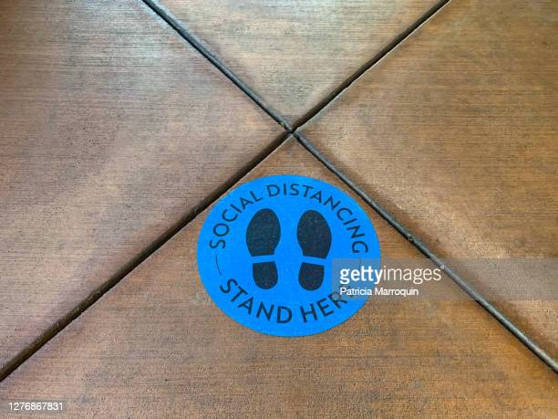 """""""social distancing—stand here"""" sign - shoe print stock pictures, royalty-free photos & images"""