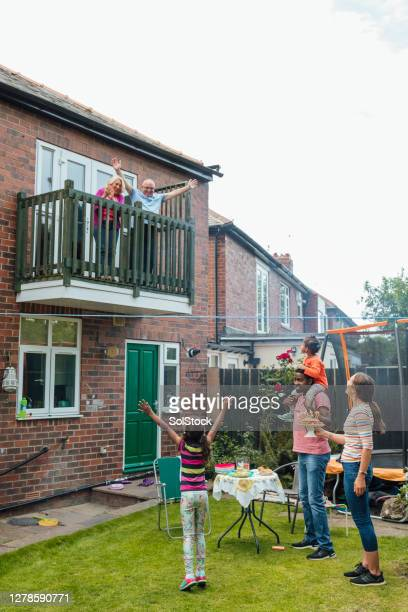 social gathering during a pandemic - social distancing stock pictures, royalty-free photos & images