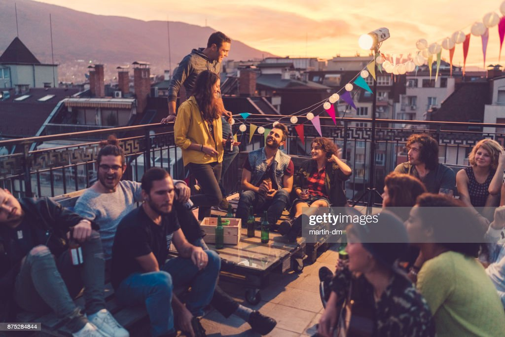 Social gathering on the rooftop : Stock Photo