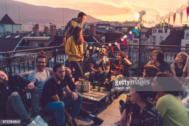 social gathering on the rooftop - friends stock pictures, royalty-free photos & images