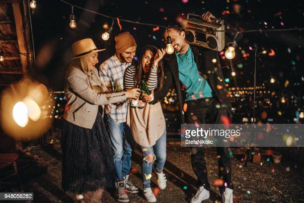 social gathering on the rooftop - friday stock pictures, royalty-free photos & images