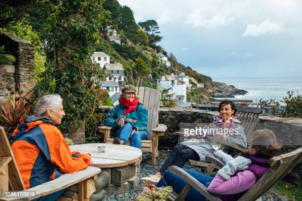 social gathering while social distancing - social distancing stock pictures, royalty-free photos & images